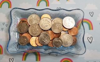 saving money change dish of money