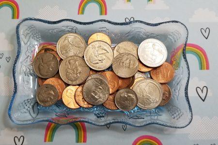 saving money change dish of money