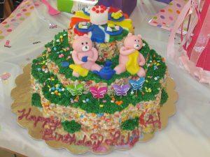 4th birthday bears having tea party cake